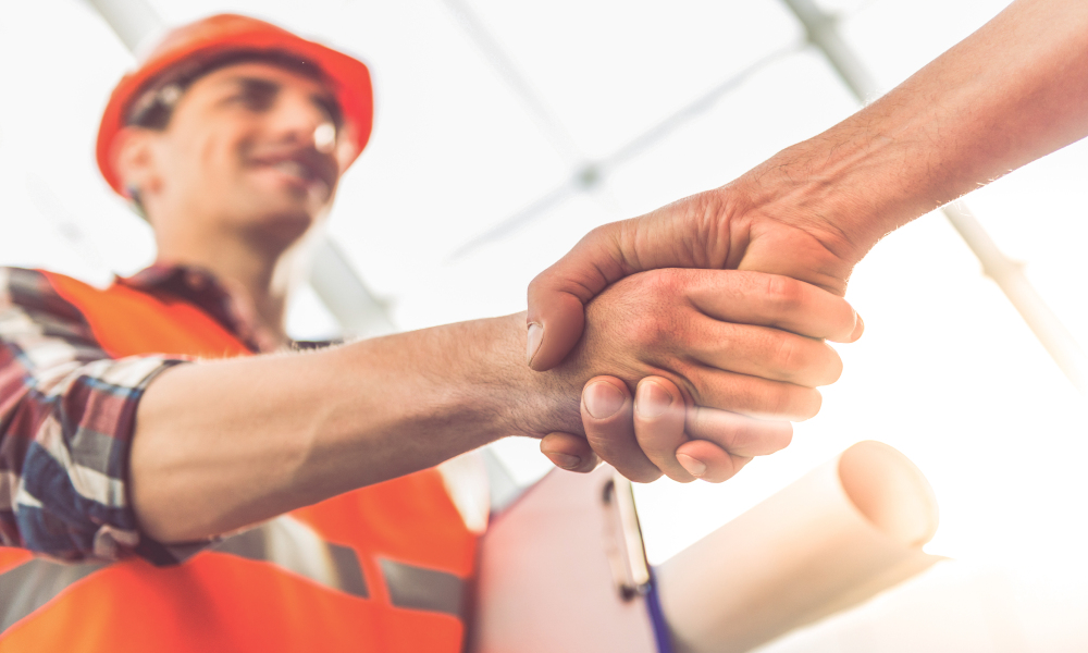 construction handshake dealio stock image