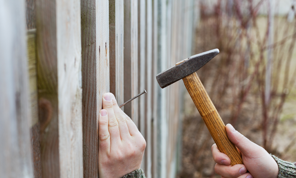 fence building hammer nail stock image