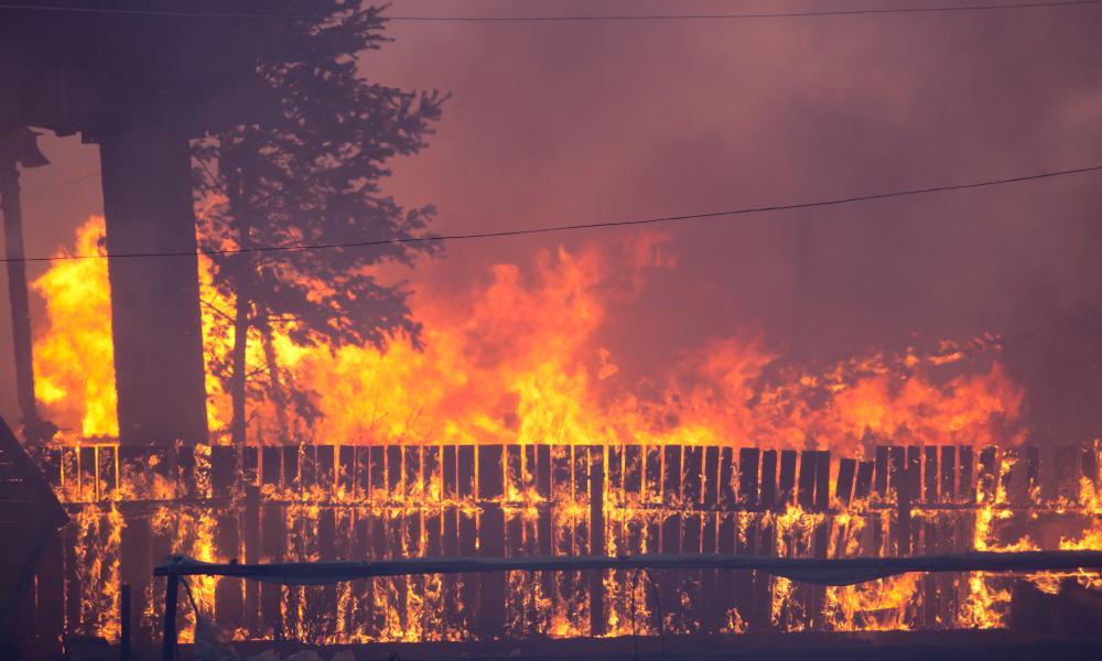 bushfire burning fence stock image